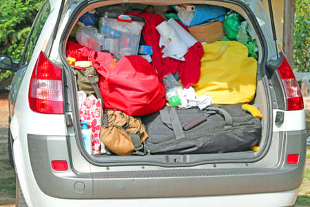 duffle: Trunk overloaded with bags and bags for family summer holidays by the sea Stock Photo