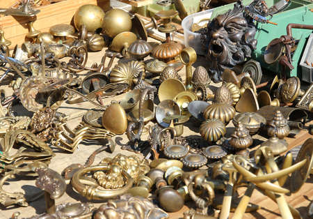 collection of ancient bronze handles for sale at flea market photo