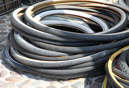 bloating: bunch of old bicycle tires for sale at market