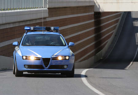 police car running fast while the patrol road in city photo