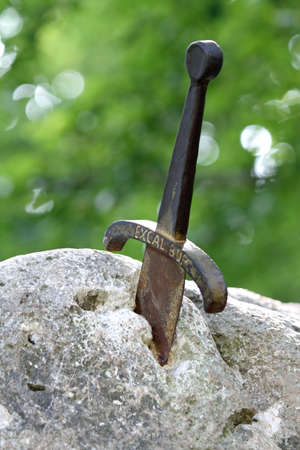 medieval blacksmith: handle of the sword of excalibur stuck in the rock