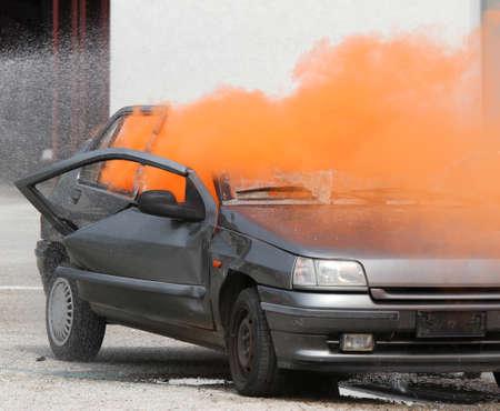 Dense Orange smoke escapes from the car destroyed 版權商用圖片