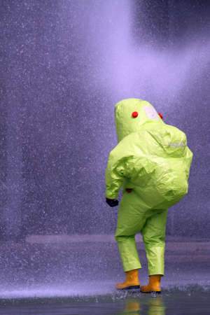 chemical warfare: man with the yellow jumpsuit for the biohazard during a chemical warfare simulation