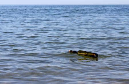 castaway: secret message in bottle in the sea Stock Photo