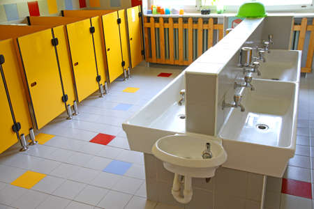 bathrooms and low sinks in a school for young children Stock Photo - 31392510
