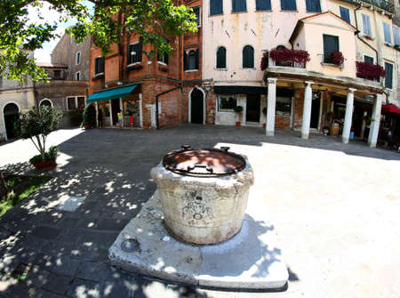 jewish houses: well in the square of the Jewish ghetto of Venice in Italy