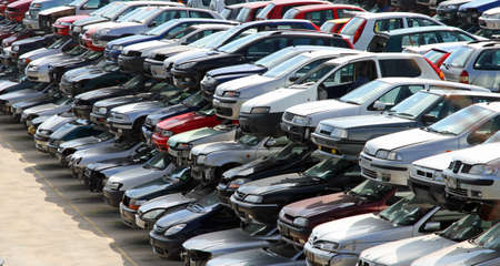 salvage yard: destroyed cars in car demolition in the city
