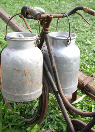 milk cans: very rusty old bike of the milkman with two old milk cans