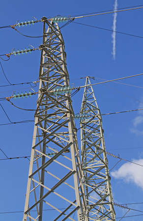 huge pylon of the high voltage electric cables in power station photo