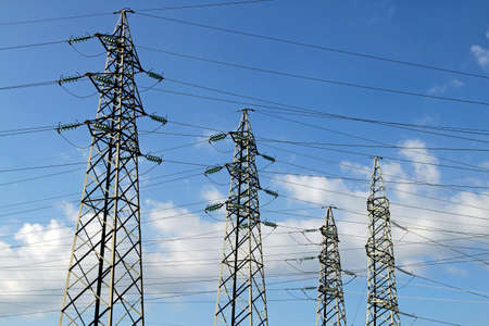 electromagnetism: pylons of the high voltage electric cables in power station