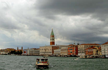 st  mark's: Venice with the bell tower of Saint Mark and the boats into the sea Stock Photo