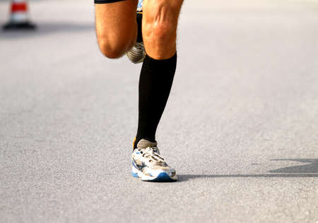 frenetic: very fast runner with sneakers during the Marathon on road Stock Photo