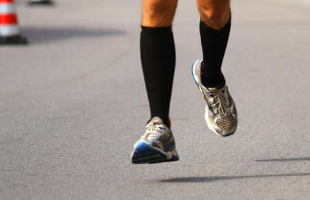 frenetic: very fast runner with sneakers during the Marathon on paved road