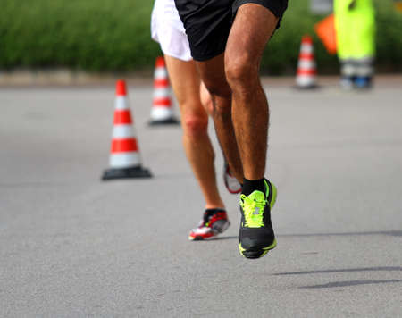 frenetic: Marathoner runs very fast for the paved road in the final sprint to the finish line first