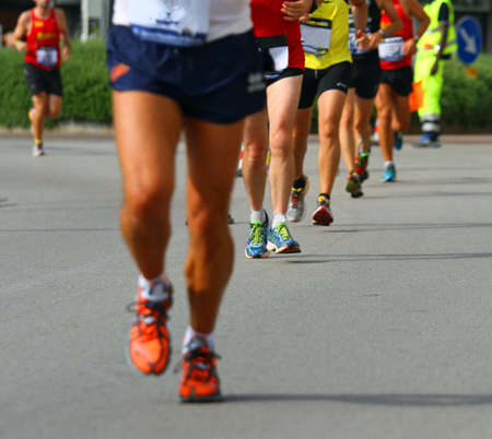 muscular legs of athletes engaged in long international marathon