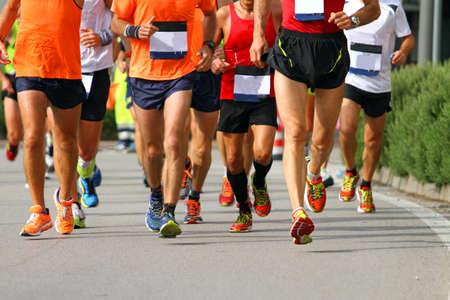 muscular legs of athletes engaged in long international marathon