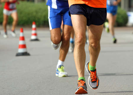 athletes  legs with sneakers run fast to the finish line photo