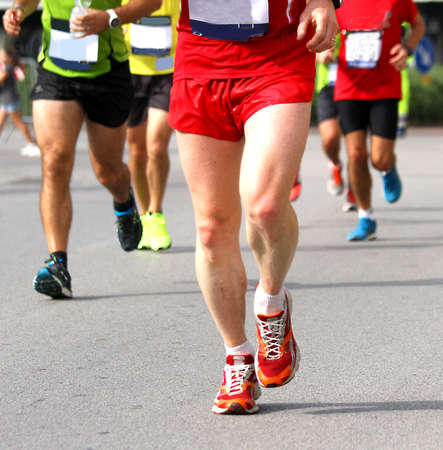 get tired: Group of athletes of various nationalities run fast Marathon in the streets