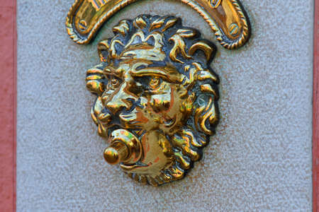 door bell: door bell in the shape of a lion with the key in the mouth