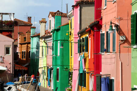 A lot of colorful houses on the island of BURANO near Venice in Italy photo