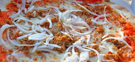 Tasty pizza with mozzarella tomato and onion with tuna photo