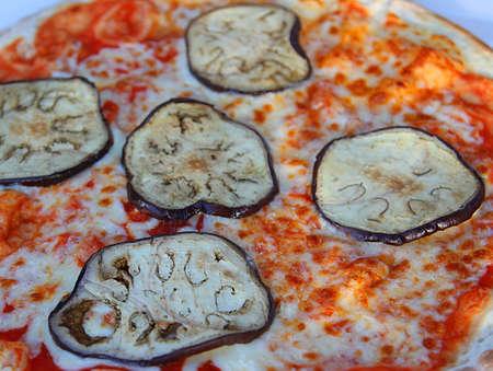 Tasty pizza with mozzarella tomato and grilled aubergines photo