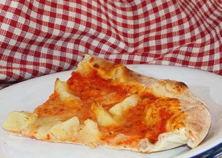 tasty pizza with mozzarella and tomato and roast potatoes at Italian restaurant photo