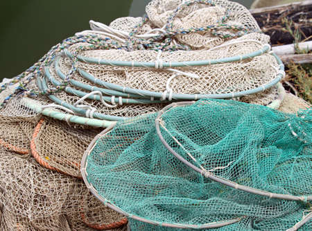 bunch of fishing nets of fishermen just returned to the naval port photo
