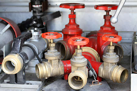 red Sleeve valves and fire lances of trucks of firefighters photo