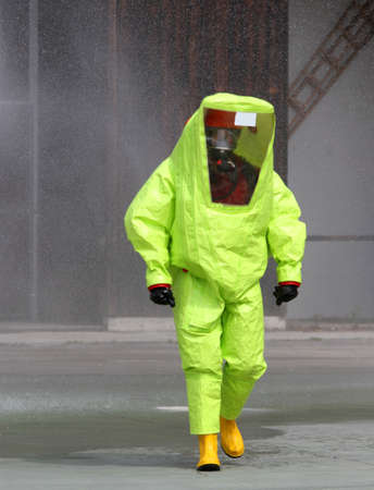man with yellow radiation suit and infectious diseases photo