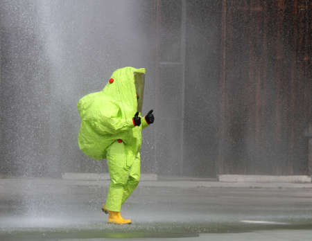 soldier with yellow suit protective radiation defense and infectious diseases