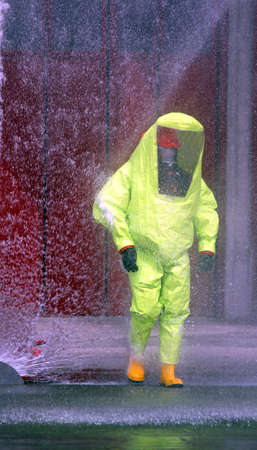 Firefighter protective yellow jumpsuit with for protection from radiation and chemical agents photo