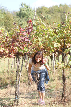nice young woman in the vineyard in autumn in the Italian hills photo