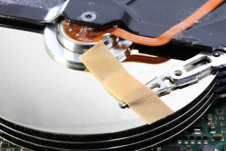 hard disk failure with a band-aid over your disks photo
