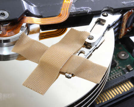 hard disk failure with a bandage  over your disks photo