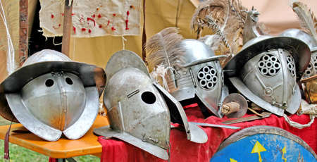 armor and helmets of ancient Roman origin and medieval helmets of brave knights and soldiers photo