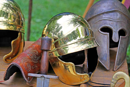 roman helmets and medieval helmets of brave knights and soldiers photo