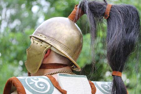 ancient Roman soldier with antique helmet photo