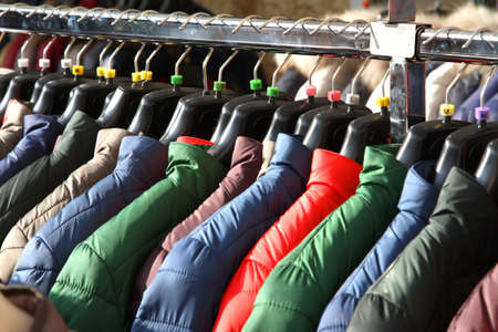 padded: warm winter JACKETS for sale at shopping center Stock Photo