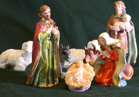 Mary and Joseph with the child Jesus in the manger with a shepherd
