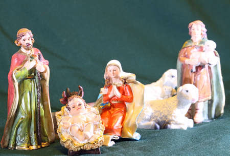 Mary and Joseph with the child Jesus in the manger with a shepherd and sheep Stock Photo
