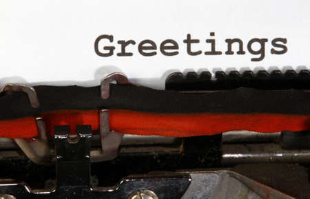 greetings written with black ink with the old typewriter Banco de Imagens