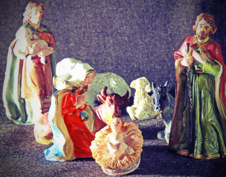 Mary and Joseph with the child Jesus in the manger with a shepherd photo