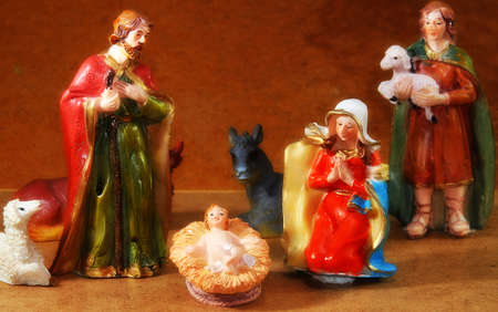 Nativity scene with Mary and Joseph and the baby Jesus near Shepherd photo