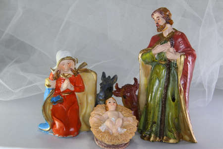 presepio: characters of the crib with baby Jesus in the crib and white background Stock Photo