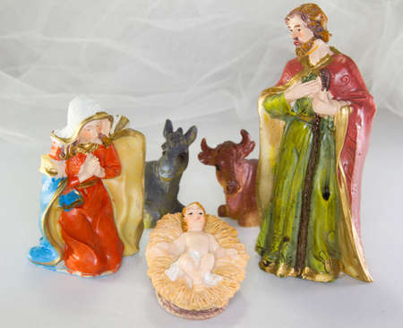 nativity scene with baby Jesus in the crib and white background