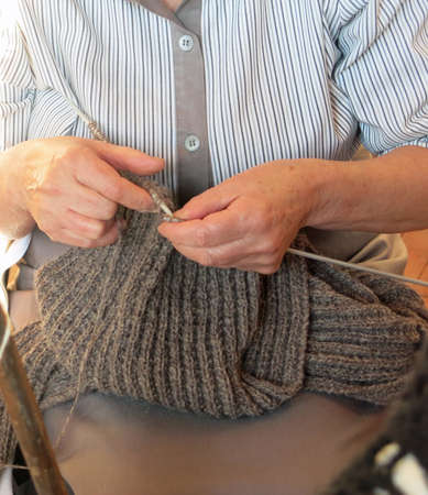 seniority: elderly woman knit with knitting needles Stock Photo