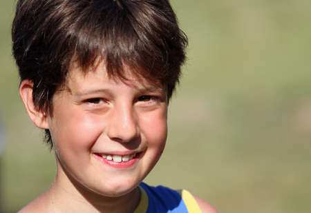 young boy smiling: Nice Italian young boy smiling in summer