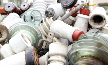 hazardous waste: old ceramic insulators in an old dump obsolete material and hazardous waste