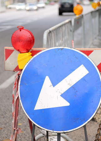 Sign with arrow to roadworks and street excavation photo